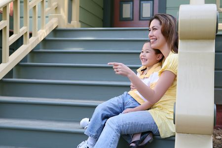 A pretty mother and cute son sitting on porch at home Stock Photo - 2892807