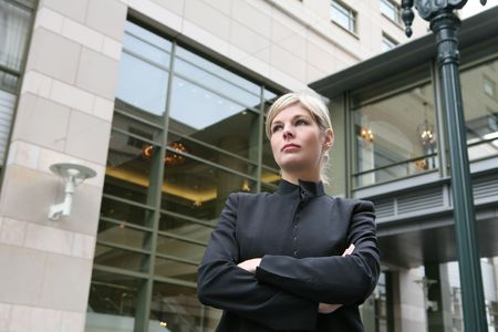 A pretty blonde business woman in downtown urban district photo