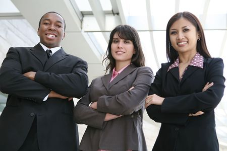 filipino ethnicity: An attractive team of diverse business people smiling at company