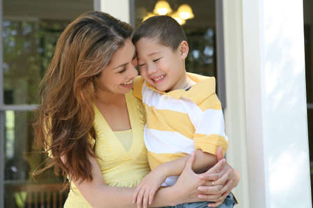 A cute boy hugging his mother at their home Stock Photo - 2935076