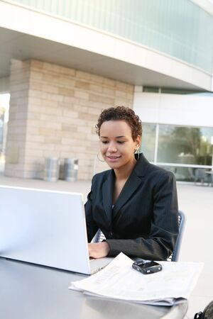 academia: A pretty african american business woman on computer