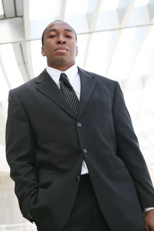 A young, handsome business man standing outside his office building Stock Photo - 2935176