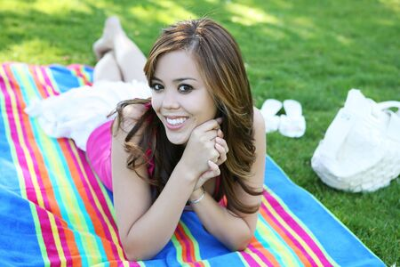 A beautiful young teenage girl in the park Stock Photo