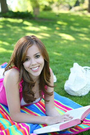 A beautiful young teenage girl in the park Archivio Fotografico