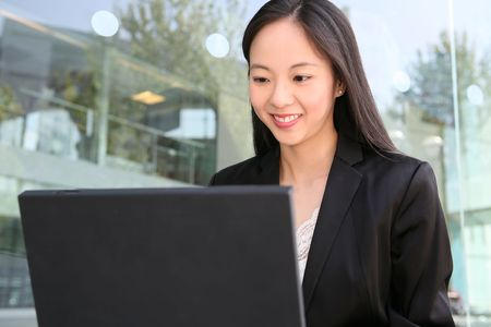 A pretty asian business woman working on the laptop Stock Photo - 3018321
