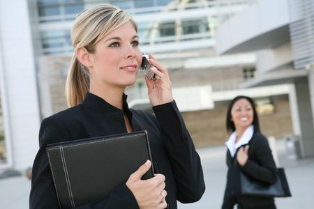 A beautiful blonde business woman on the phone at work photo