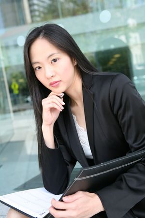 A beautiful asian business woman in office building Stock Photo - 3018322