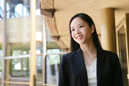 A beautiful asian business woman at golden office building Stock Photo - 3030310