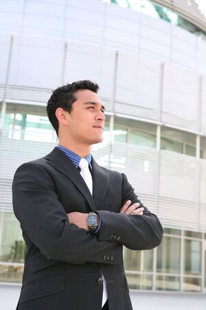 mature mexican: A handsome hispanic business man in front of office building