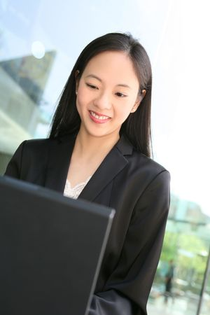 A pretty asian business woman working on the laptop Stock Photo - 3062396