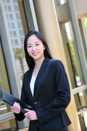 A beautiful asian business woman at office building photo