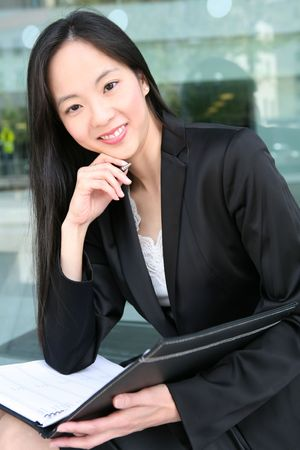 A beautiful asian business woman in office building photo