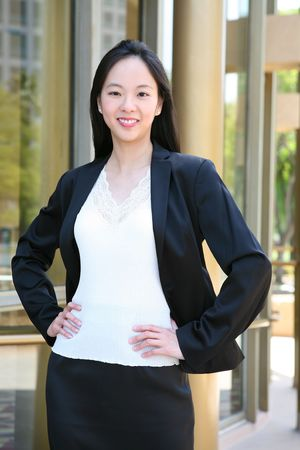 A beautiful asian business woman at golden office building photo