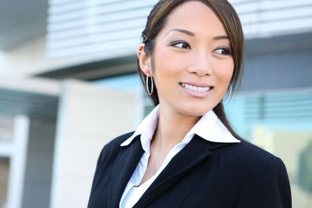 A pretty asian business woman at the office building photo