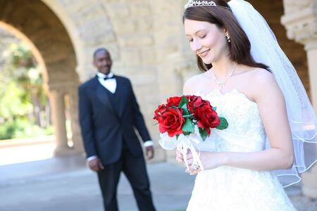 An attractive man and woman wedding couple ready to be married