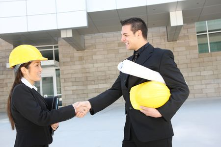 A man and woman architect on a construction site