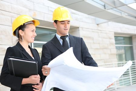 executive helmet: An attractive business team working construction on the building site