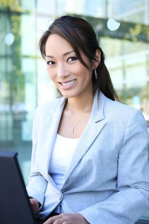 A young, beautiful asian business woman at office building Stock Photo - 3208068