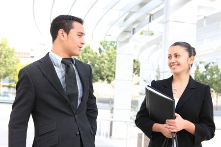A man and woman business team at their company office building photo