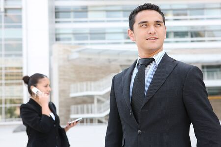 A handsome business man in front of his office building Stock Photo