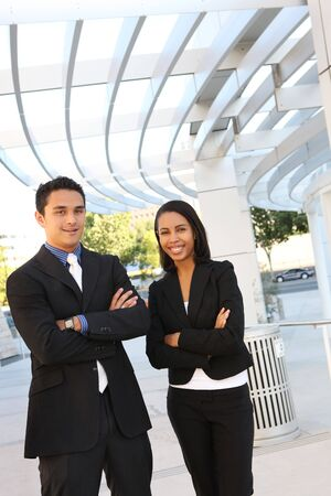 A diverse man and woman business team at their company office building photo