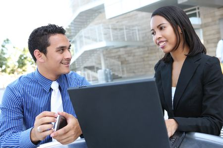 hispanic americans: A diverse man and woman business team at their company office building