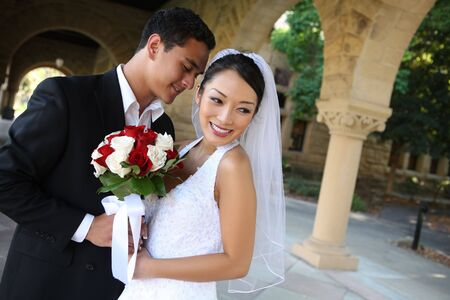 A beautiful bride and handsome groom at church during wedding 版權商用圖片