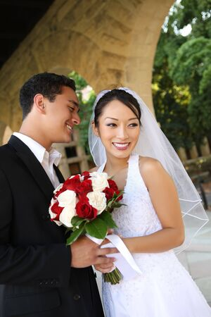 A beautiful bride and handsome groom at church during wedding photo