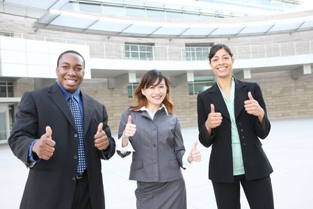 An attractive team of diverse business people at company office building photo