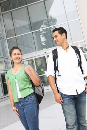Attractive students at college walking on campus photo