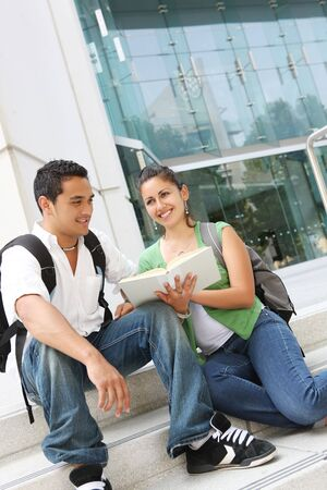Attractive students relaxing on college university campus  photo