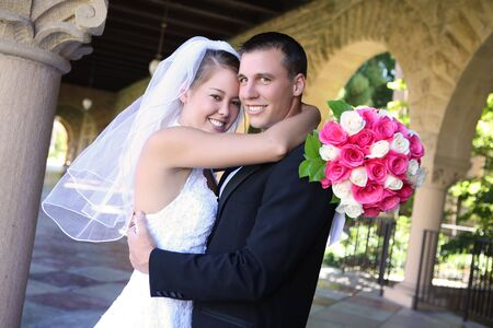 A beautiful bride and handsome groom at church during wedding Stock Photo - 3349576