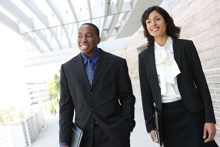 An attractive, african american business team meeting as a group Stock Photo - 3364004