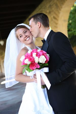 A beautiful bride and handsome groom at church during wedding Stock fotó