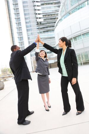 contact: A team of diverse business people at office building celebrating success