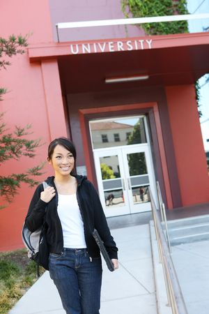 young leave: A pretty young asian woman at university walking to class Stock Photo