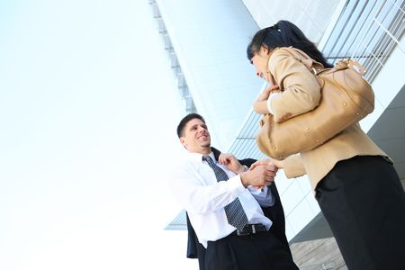 A handsome caucasian business man shaking hands with woman photo