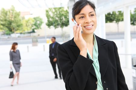 A pretty african american business woman on phone at office building photo