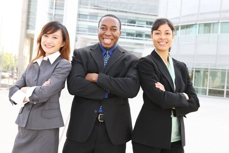 chinese american: An attractive team of diverse business people at company office building