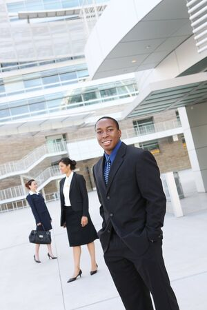 A handsome african american business man with team at office building Stock Photo - 3447147