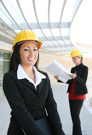 Two pretty women working as  architects on a construction site Stock Photo - 3455247