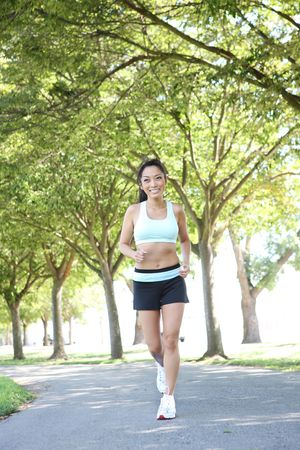 sexy asian woman: A young pretty asian woman jogging in the park