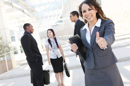 A successful, diverse, ethnic man and woman business team at office building Stock Photo - 3520549