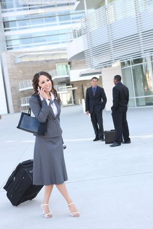 A young, pretty business woman outside office building  photo