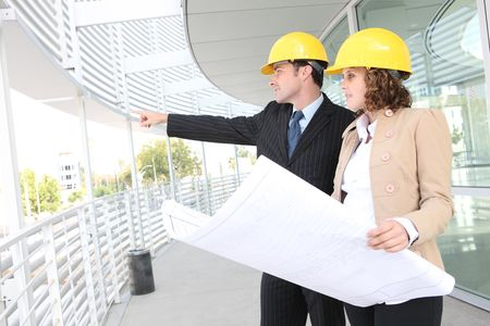 Man and woman architects on a building construction site Stock Photo