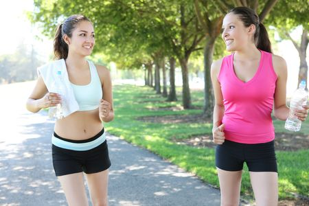 Two pretty women sisters  jogging in the park photo