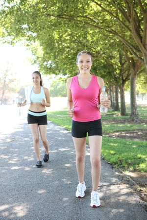 Two pretty women sisters  jogging in the park
