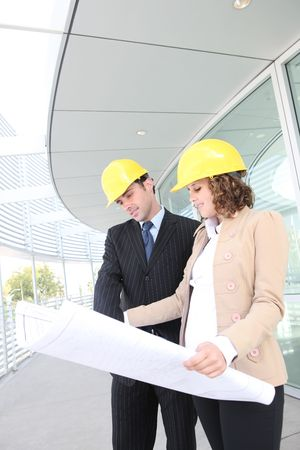 Man and woman architects on a building construction site Stock Photo - 3599338