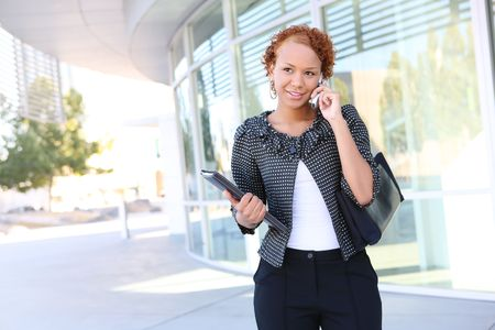 A pretty african american business woman on the cell phone Stock Photo - 3634672