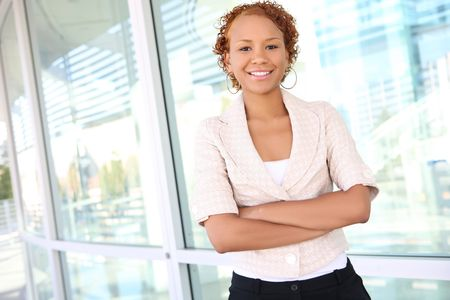 A pretty african american business woman outside office building Stock Photo - 3640641